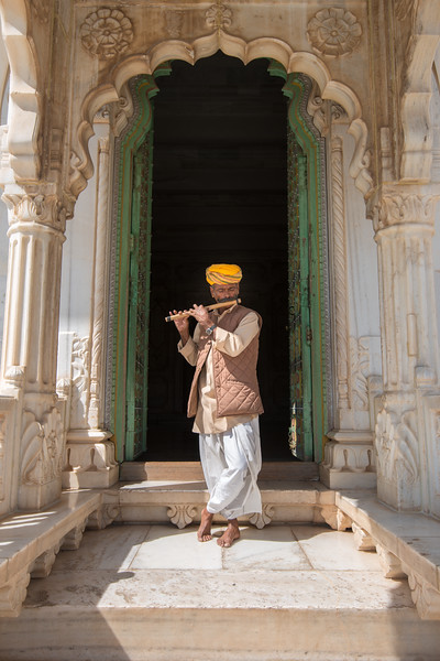 Rajasthani caretaker playing the flute at Jaswant Thada, Jodhpur, Rajasthan, Western India.