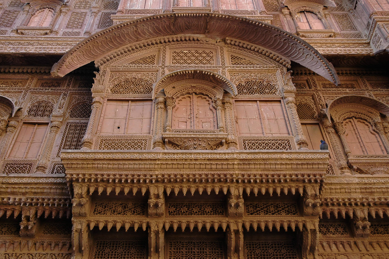 Windows and doorways of Mehrangarh Fort, Jodhpur. Very intricate design work is done on the walls. The fort is situated at an altitude of about 125 metres and is spread over an area of 5 sq. km in the heart of the city. The fort has seven gates of which the noted ones are the Jayapol, built by Maharaja Man Singh in 1806; Fatehpol or the Victory Gate built by Maharaja Ajit Singh; and the Lohapol or the Iron Gate. Jodhpur, Rajasthan, Western India.