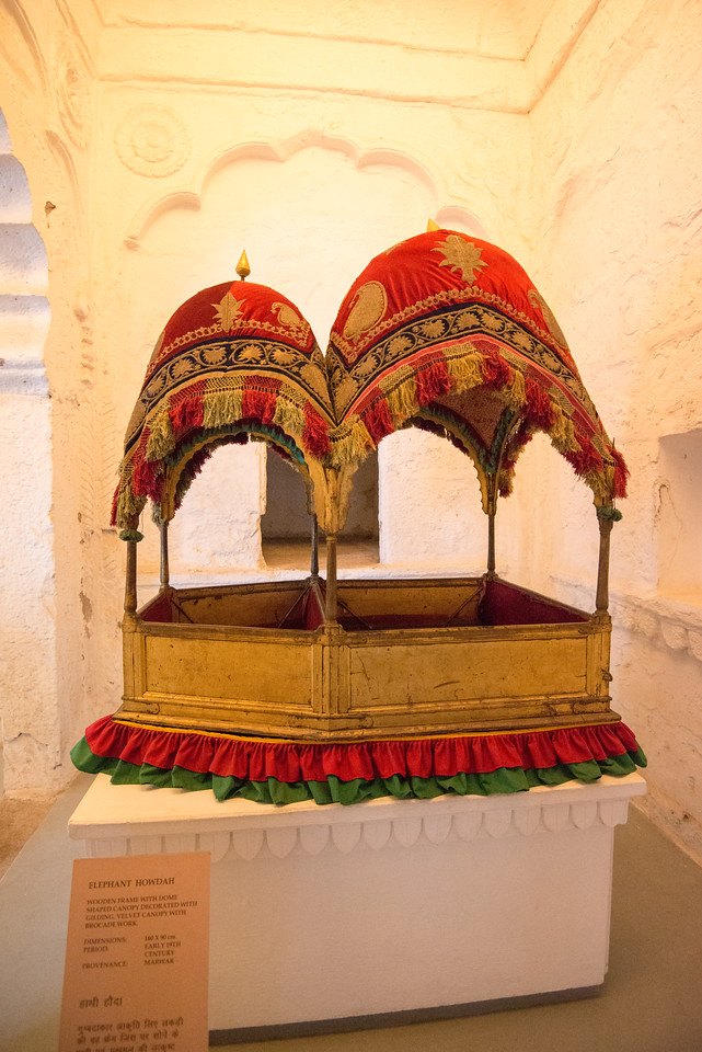 The museum in the Mehrangarh fort is one of the most well-stocked museums in Rajasthan. In one section of the fort museum there is a selection of old royal palanquins, including the elaborate domed gilt Mahadol palanquin which was won in a battle from the Governor of Gujarat in 1730. The museum exhibits the heritage of the Rathores in arms, costumes, paintings and decorated period rooms. Mehrangarh Fort, Jodhpur, Rajasthan, India.