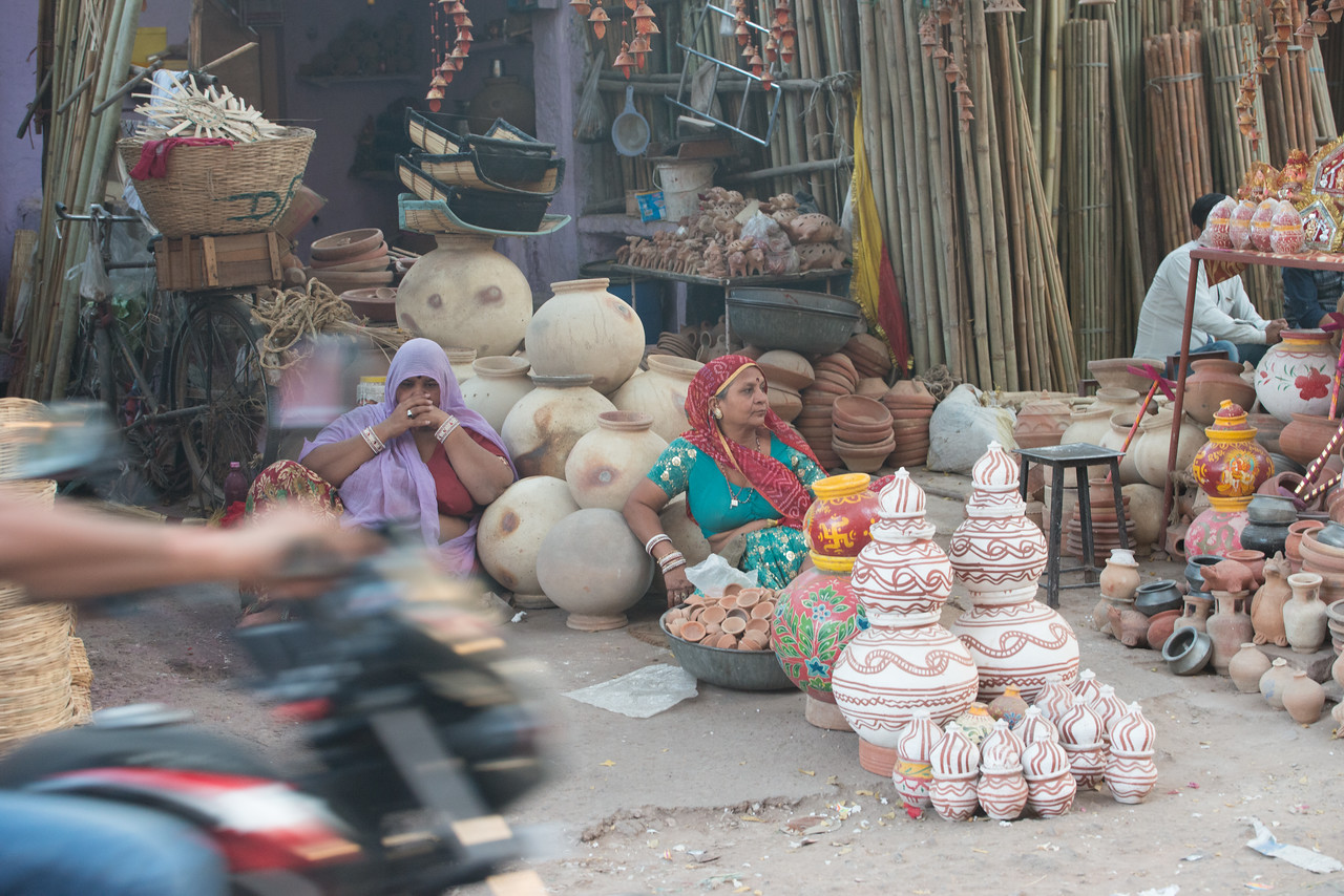 Women selling pots and other earthen products near Ghantaghar market (Clock Tower), Jodhpur, Rajasthan, India.