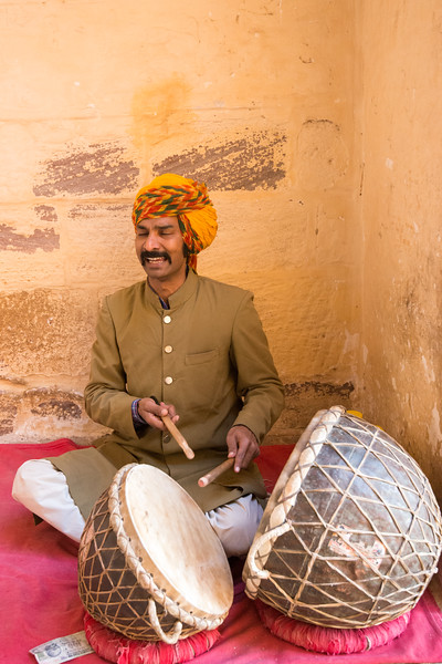 Musician at the entrance to Mehrangarh Fort, Jodhpur, Rajasthan, India.