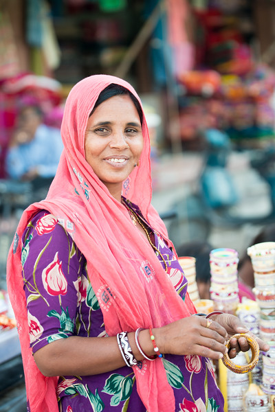 Women selling bangles and other items at the Clock Tower, Ghantaghar market, Jodhpur, Rajasthan, India.