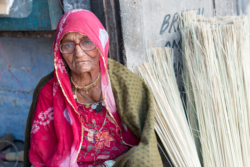 Old lady making and selling brooms at Jodhpur, Rajasthan, India