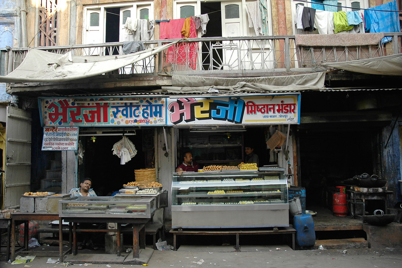 """Bherji Sweet home and Bherji Mishthan Bhandar"". Mithai shop (Sweets shop) in Jodhpur. Daily life in Jodhpur city. Jodhpur is a very popular places for tourists to experience life in Rajasthan, India."