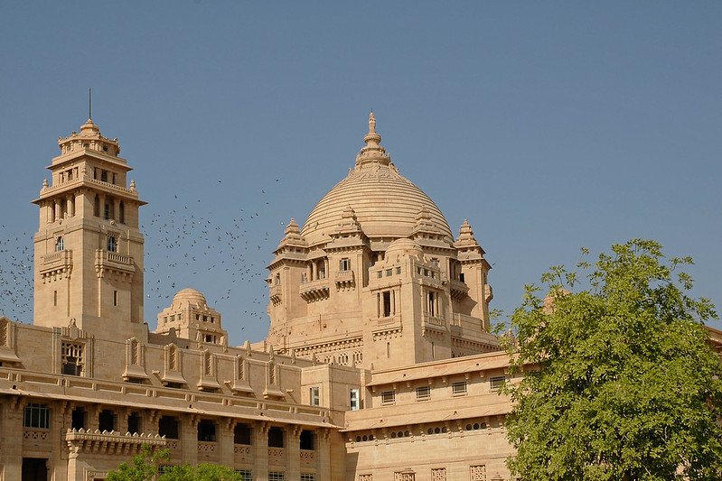 Umaid Bhawan Palace Museum in Jodhpur was constructed by Maharaja Umaid Singh. Maharaja Umaid Singh was a person with elegant and sophisticated taste. He was deeply attracted to the western lifestyle and its elegant architectures. With this thought he hired the famous Edwardian architect, Henry Vaughan Lanchester, for the Umaid Bhavan Palace. The maharaja got the palace constructed with the purpose of providing employment to famine stricken farmers. The palace consists of 347 rooms. All the rooms are spacious, gorgeously decorated and reflect a rich ambience. Jodhpur Umaid Bhawan Palace was one of the last palaces to be built in India. Jodhpur, Rajasthan, Western India. The attractions of the Umaid Bhawan Palace in Jodhpur include the Throne Room (housing fascinating Ramayana murals), a wood-paneled library, a private museum. The well appointed museum showcases an array of weapons, stuffed leopards, clocks and a huge banner presented by Queen Victoria.<br /> <br /> Constructed of marble and pink sandstone this immense palace is also known as the Chhittar Palace because it uses local Chittar sandstone. Construction begun in 1929, and took 15 years to complete. Umaid Singh died in 19478, four years after the palace was completed; the current Maharaja Gaj Singh II, continues to live in part of the building. The rest has been converted into a hotel.