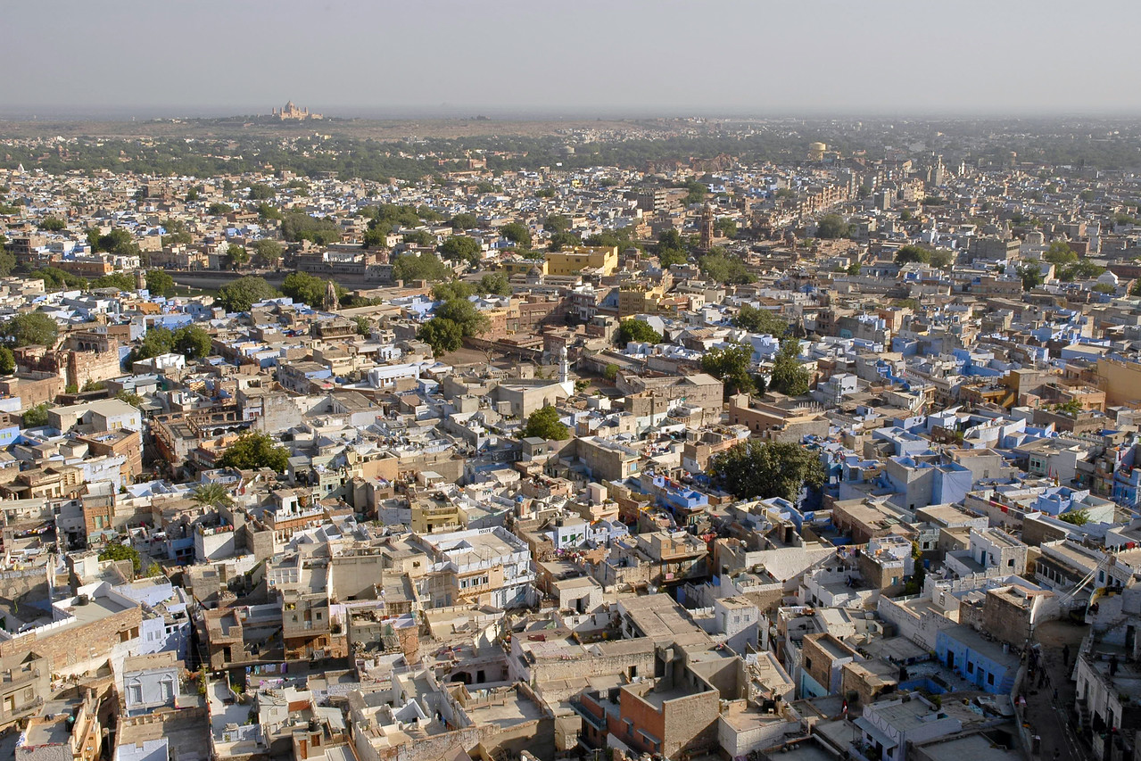View of the blue city of Jodhpur as seen from the magnificent Mehrangarh, one of Rajasthan's finest forts. The fort is situated at an altitude of about 125 metres and is spread over an area of 5 sq. km. Jodhpur, Rajasthan, Western India.