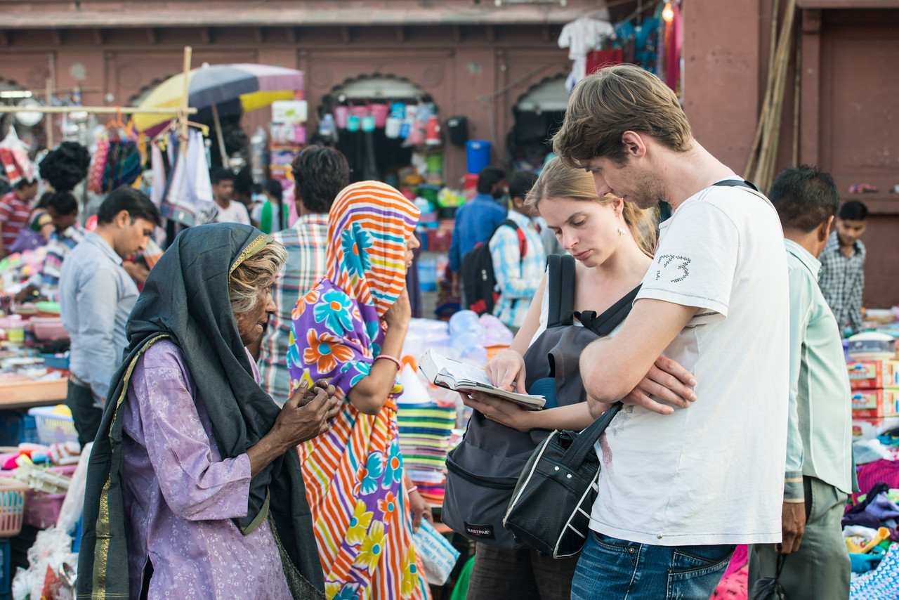 Western tourists at Ghantaghar market (Clock Tower), Jodhpur, Rajasthan, India.
