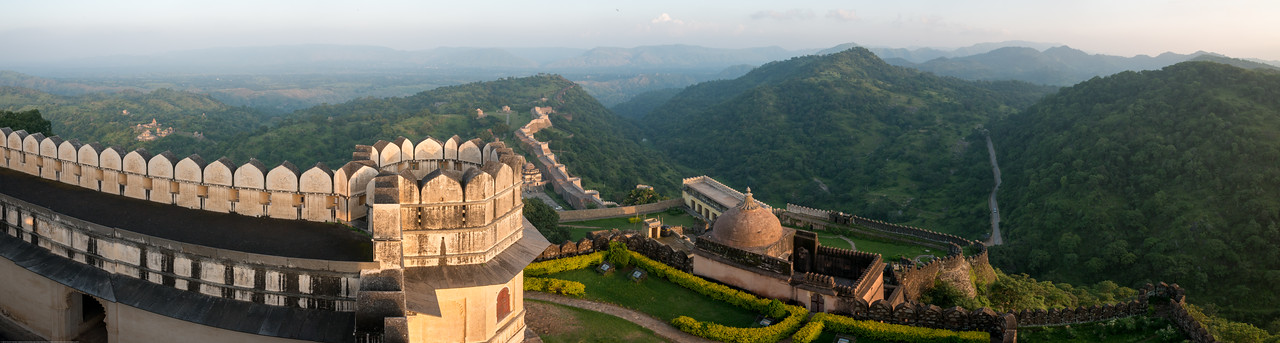 Panoramic aerial view of a portion of the Kumbhalgarh. Kumbhalgarh Fort located on the westerly range of Aravalli Hills, in the Rajsamand District of Rajasthan state in western India is a Mewar fortress. It is a World Heritage Site included in Hill Forts of Rajasthan as per UNESCO. Built during the course of the 15th century by Rana Kumbha and enlarged through the 19th century, Kumbhalgarh is also the birthplace of Maharana Pratap, the great king and warrior of Mewar. The frontal walls are fifteen feet thick. Kumbhalgarh has seven fortified gateways. From the palace top, it is possible to see kilometers into the Aravalli Range.