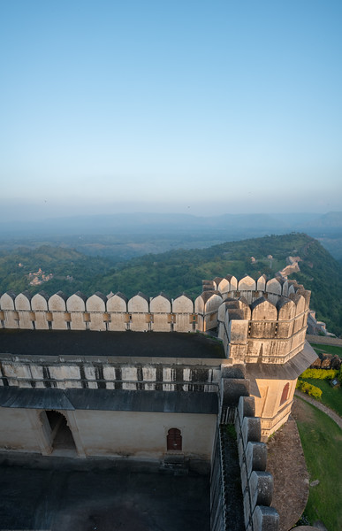 Kumbhalgarh Fort located on the westerly range of Aravalli Hills, in the Rajsamand District of Rajasthan state in western India is a Mewar fortress. It is a World Heritage Site included in Hill Forts of Rajasthan as per UNESCO. Built during the course of the 15th century by Rana Kumbha and enlarged through the 19th century, Kumbhalgarh is also the birthplace of Maharana Pratap, the great king and warrior of Mewar. The frontal walls are fifteen feet thick. Kumbhalgarh has seven fortified gateways. There are over 360 temples within the fort, 300 ancient Jain and the rest Hindu. From the palace top, it is possible to see kilometers into the Aravalli Range. The sand dunes of the Thar Desert can be seen from the fort walls.