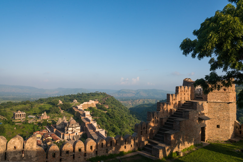 Aerial view of a portion of the Kumbhalgarh wall. Built on a hilltop 1,100 m (3,600 ft) above sea level on the Aravalli range, the fort of Kumbhalgarh has perimeter walls that extend 36 km (22 mi), making it the second longest wall in the world. Kumbhalgarh Fort located on the westerly range of Aravalli Hills, in the Rajsamand District of Rajasthan <br /> state in western India is a Mewar fortress. Built during the course of the 15th century by Rana Kumbha and enlarged through the 19th century.