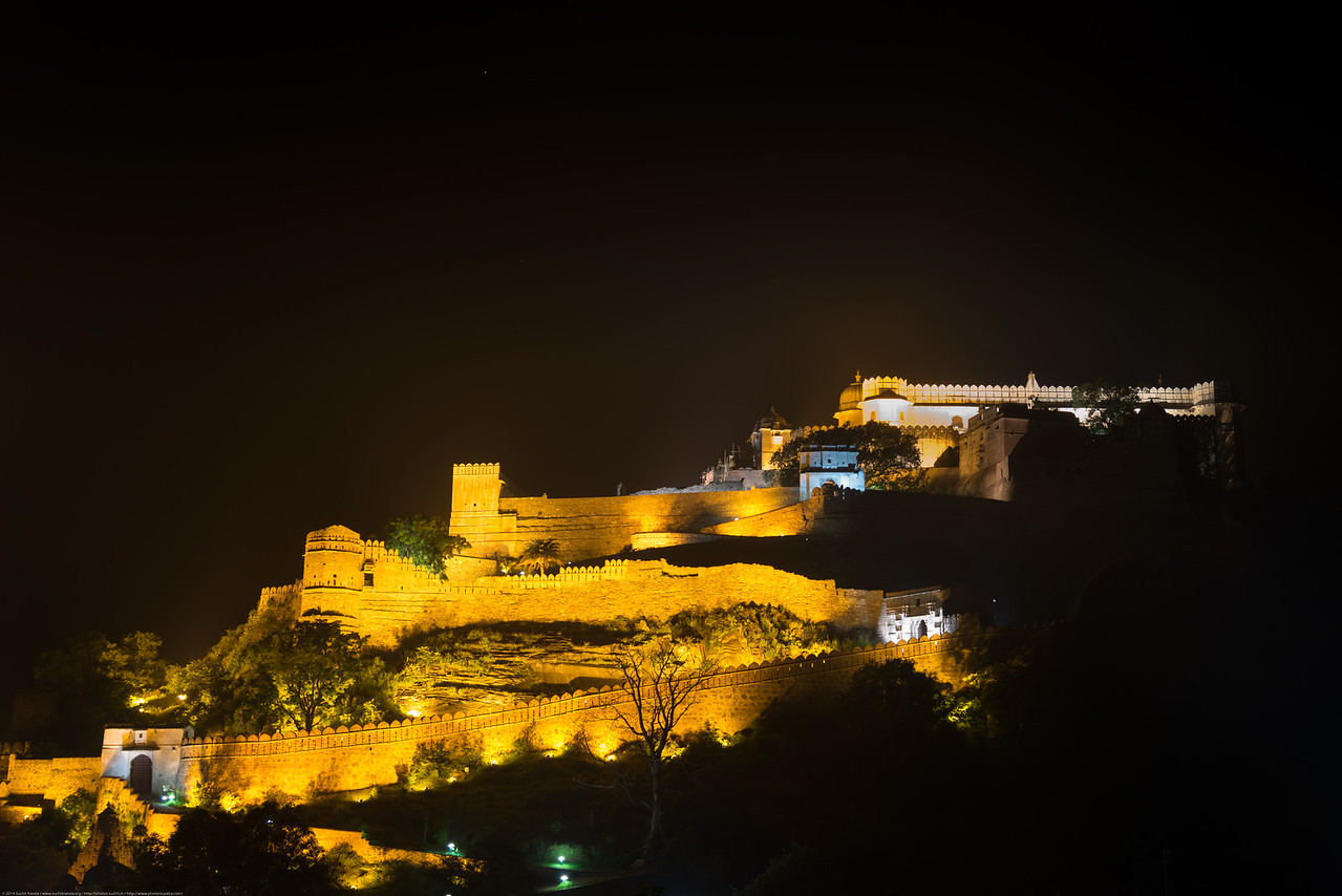 At night the Kumbhalgarh Fort is beautifully lit up and can be seen from great distances. The fort located on the westerly range of Aravalli Hills, in the Rajsamand District of Rajasthan state in western India is a Mewar fortress. It is a World Heritage Site included in Hill Forts of Rajasthan as per UNESCO. Built during the course of the 15th century by Rana Kumbha and enlarged through the 19th century, Kumbhalgarh is also the birthplace of Maharana Pratap, the great king and warrior of Mewar.