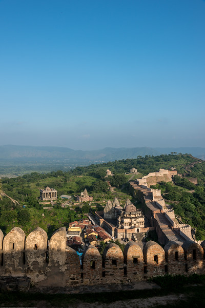 Aerial view of a portion of the Kumbhalgarh wall. Built on a hilltop 1,100 m (3,600 ft) above sea level on the Aravalli range, the fort of Kumbhalgarh has perimeter walls that extend 36 km (22 mi), making it the second longest wall in the world. Kumbhalgarh Fort located on the westerly range of Aravalli Hills, in the Rajsamand District of Rajasthan state in western India is a Mewar fortress. It is a World Heritage Site included in Hill Forts of Rajasthan as per UNESCO. Built during the course of the 15th century by Rana Kumbha and enlarged through the 19th century, Kumbhalgarh is also the birthplace of Maharana Pratap, the great king and warrior of Mewar.