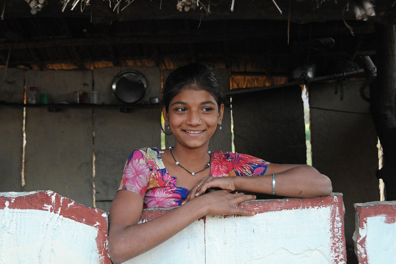 Young lady at her village home in Chamunda Matha Road, Pushkar.<br /> <br /> The town of Pushkar is located 14 km North West of Ajmer. Pushkar is one of the oldest cities of India. It  has in recent years become a popular destination for foreign tourists. Pushkar, Rajasthan, India.