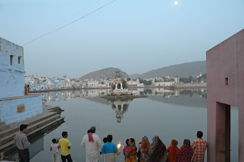 Devote Hindus perform puja at the Pushkar Lake, Rajasthan during the evening aarti.<br /> <br /> The town of Pushkar is located 14 km North West of Ajmer. Pushkar is one of the oldest cities of India. It  has in recent years become a popular destination for foreign tourists. Pushkar, Rajasthan, India.