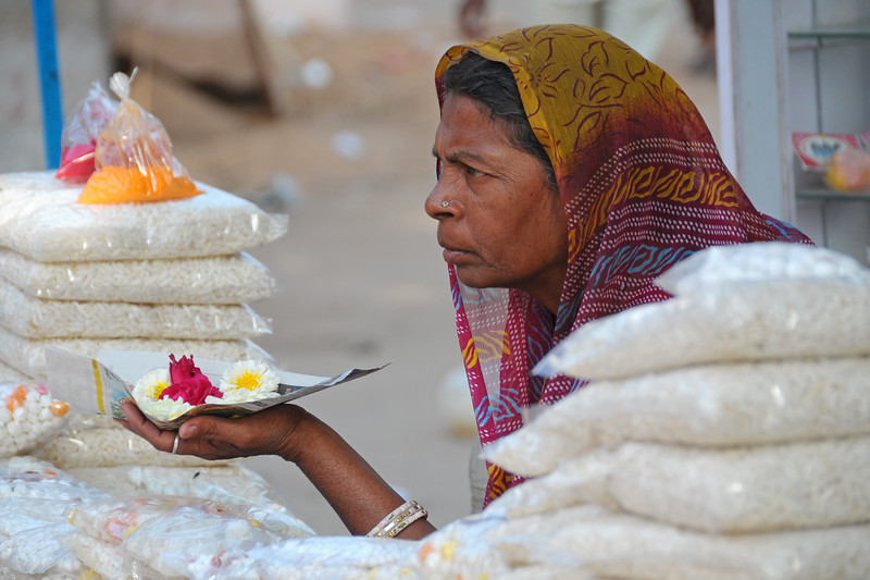 Lady selling flowers for puja (prayers) at Pushkar.<br /> <br /> The town of Pushkar is located 14 km North West of Ajmer. Pushkar is one of the oldest cities of India. It  has in recent years become a popular destination for foreign tourists. Pushkar, Rajasthan, India.