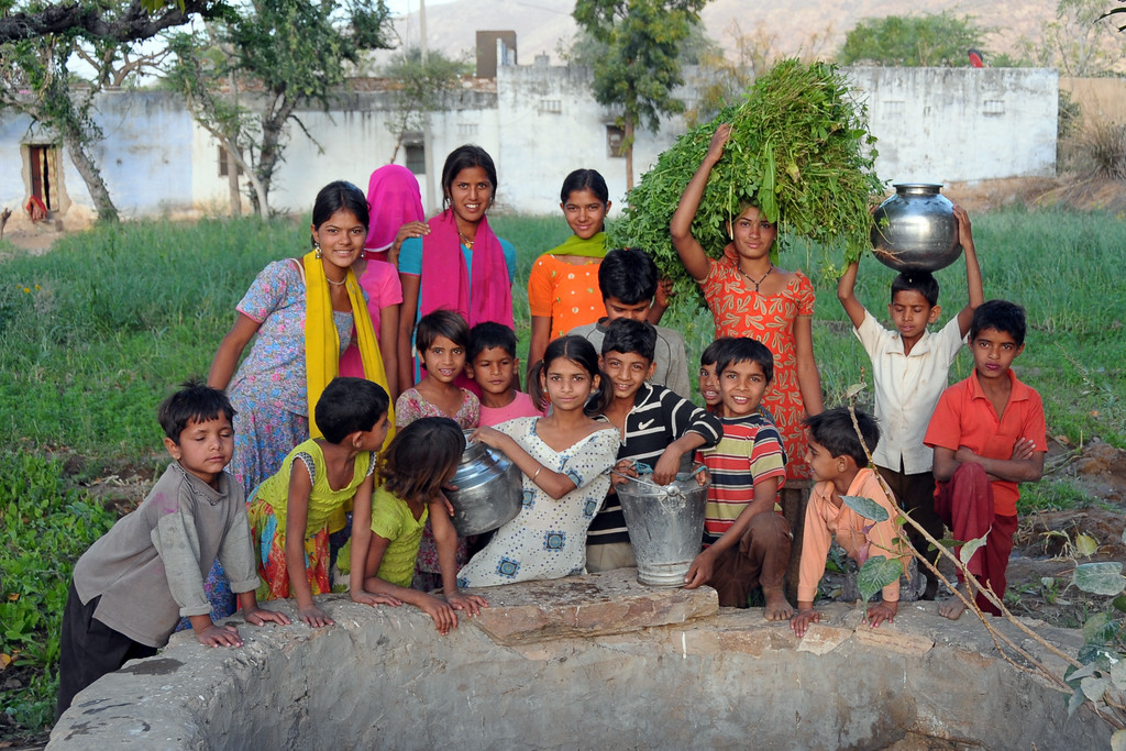 Children at the well Chamunda Matha Road, Pushkar.<br /> The town of Pushkar is located 14 km North West of Ajmer. Pushkar is one of the oldest cities of India. It  has in recent years become a popular destination for foreign tourists. Pushkar, Rajasthan, India.