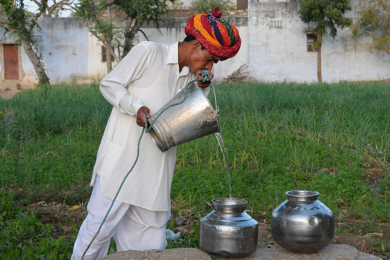 Sayar Singh fetching water from his well in Chamunda Matha Road, Pushkar.<br /> <br /> The town of Pushkar is located 14 km North West of Ajmer. Pushkar is one of the oldest cities of India. It  has in recent years become a popular destination for foreign tourists. Pushkar, Rajasthan, India.