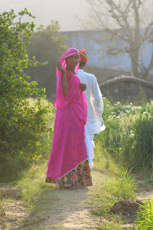 Sayar Singh and his wife in Chamunda Matha Road, Pushkar.<br /> <br /> The town of Pushkar is located 14 km North West of Ajmer. Pushkar is one of the oldest cities of India. It  has in recent years become a popular destination for foreign tourists. Pushkar, Rajasthan, India.