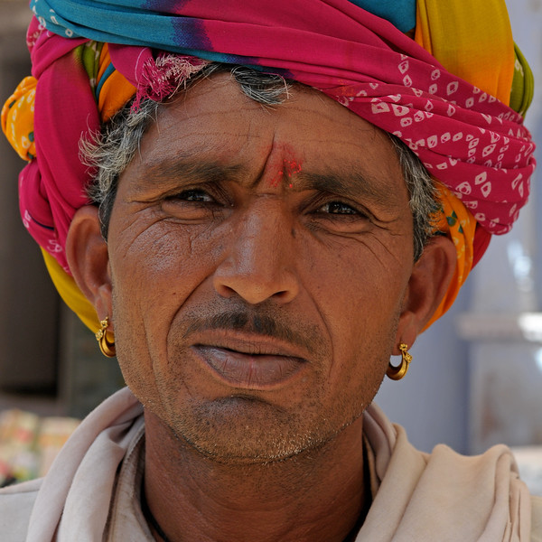 Rajasthani men and women in their traditional attire in Pushkar.<br /> <br /> The town of Pushkar is located 14 km North West of Ajmer. Pushkar is one of the oldest cities of India. It  has in recent years become a popular destination for foreign tourists. Pushkar, Rajasthan, India.