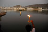 Evening aarti (pooja) on the banks of the lake. The Pushkar lake is surrounded by hills on three sides and desert on the other side. The cave of Saint Agasthya was located on the snake mountain here. There is one belief that Kalidasa, the Indian counterpart of Shakespeare, had this place as his locale for his Sanskrit drama, Shakuntalam. According to a legend, the lake was formed when Lord Brahma dropped a lotus and wanted to perform a yagna. It has world's only temple of Lord Bramha (God of Creation). The Brahma temple located in Pushkar, Rajasthan is one of the important Hindu pilgrim centre.