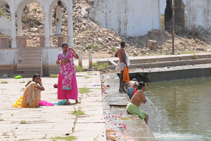 Men and women take a dip in the holy Pushkar Lake waters in Rajasthan.<br /> <br /> The town of Pushkar is located 14 km North West of Ajmer. Pushkar is one of the oldest cities of India. It  has in recent years become a popular destination for foreign tourists. Pushkar, Rajasthan, India.