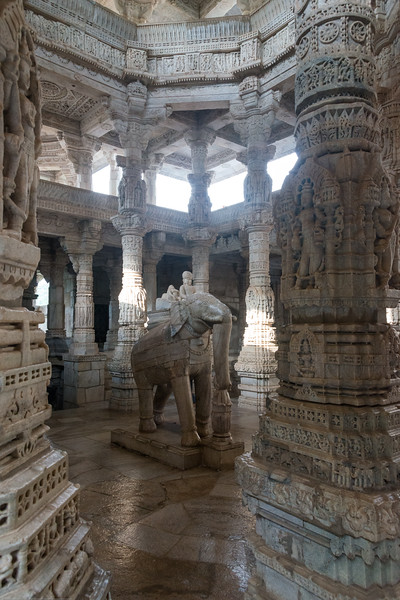 Elephant statue inside the large Jain temple in Ranakpur, Rajasthan, India. Ranakpur Jain Temple is dedicated to Tirthankara Adinatha, and said to be the most spectacular of the Jain temples and is one among the most famous places to visit in Pali, Rajasthan. Constructed between 1437 to 1458, copper-plate inscriptions at the temple record that it was inspired by a dream of a celestial vehicle, Dhanna Shah, with the patronage of Rana Kumbha, then ruler of Mewar.