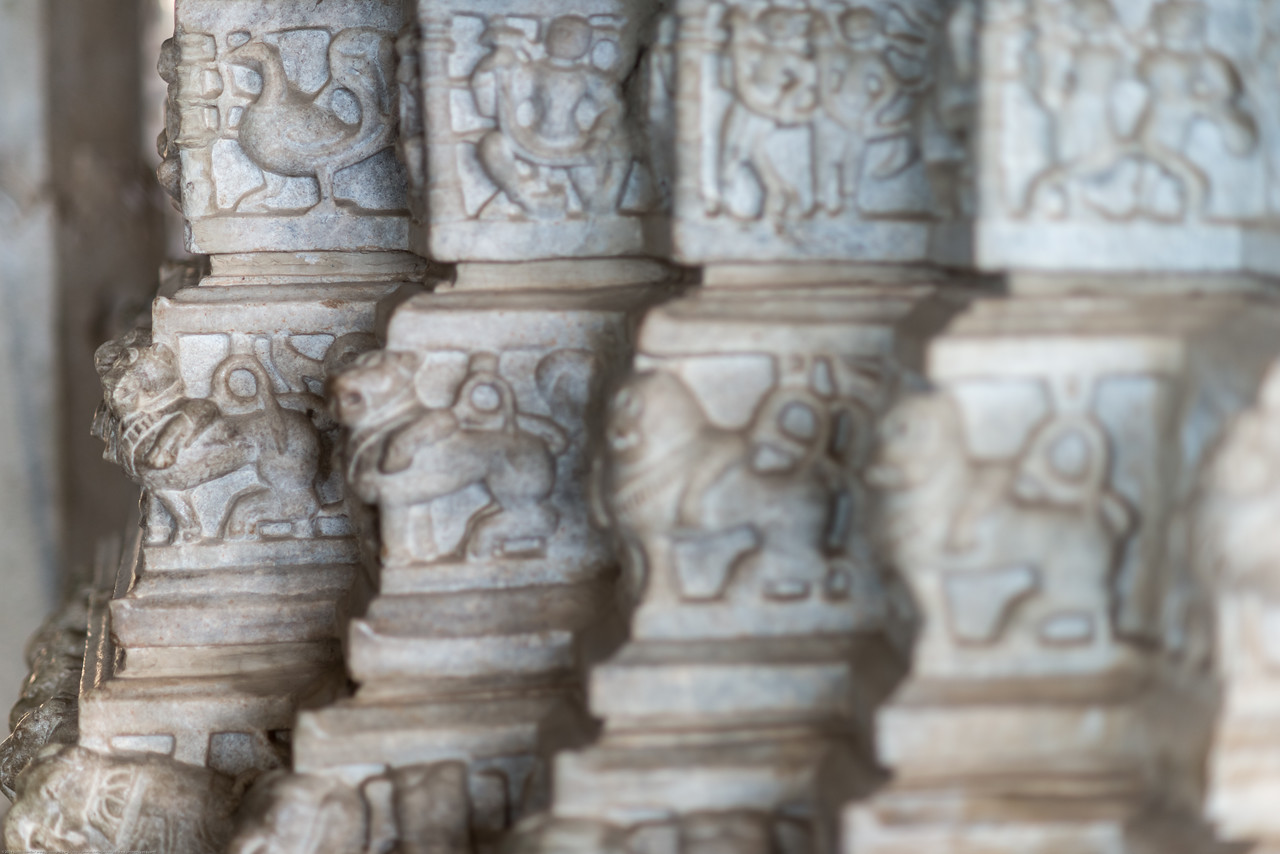 Beautiful marble carvings at Ranakpur Jain Temple<br /> Ranakpur is widely known for its marble Jain temple dedicated to Tirthankara Adinatha, and said to be the most spectacular of the Jain temples and is one among the most famous places to visit in Pali, Rajasthan. Ranakpur is a village located in a valley on the western side of the Aravalli Range. Near Sadri town in Desuri tehsil in the Pali district of Rajasthan, Western India. It is located between Jodhpur and Udaipur.<br /> <br /> Constructed between 1437 to 1458, copper-plate inscriptions at the temple record that it was inspired by a dream of a celestial vehicle, Dhanna Shah, with the patronage of Rana Kumbha, then ruler of Mewar.