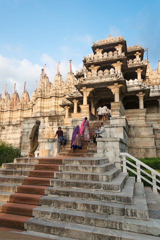 Pilgrims walking at the front entrance to Ranakpur Jain Temple. Ranakpur is widely known for its marble Jain temple dedicated to Tirthankara Adinatha, and said to be the most spectacular of the Jain temples and is one among the most famous places to visit in Pali, Rajasthan. Constructed between 1437 to 1458, copper-plate inscriptions at the temple record that it was inspired by a dream of a celestial vehicle, Dhanna Shah, with the patronage of Rana Kumbha, then ruler of Mewar.