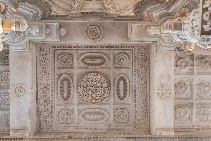 Beautifully carved marble ceiling at Ranakpur Jain Temple.<br /> Ranakpur is widely known for its marble Jain temple dedicated to Tirthankara Adinatha, and said to be the most spectacular of the Jain temples and is one among the most famous places to visit in Pali, Rajasthan. Ranakpur is a village located in a valley on the western side of the Aravalli Range. Near Sadri town in Desuri tehsil in the Pali district of Rajasthan, Western India. It is located between Jodhpur and Udaipur.<br /> <br /> Constructed between 1437 to 1458, copper-plate inscriptions at the temple record that it was inspired by a dream of a celestial vehicle, Dhanna Shah, with the patronage of Rana Kumbha, then ruler of Mewar.