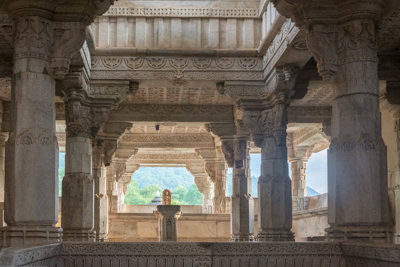 The Chaturmukha Jain Temple of Ranakpur In the heart of the remote and enchanting valley of the Arvallis, skirting the rivulet Maghai and enveloped in the solitude of the surrounding forest, stands, in solemn grandeur, the Chaturmukha Jain Temple of Rishabhadeva. Placed on a lofty plinth, the three-storeyed marble edifice, to which the genius of the artist has imparted exquisite artistic grace, and which his deep devotion has endowed with serene spiritual dignity is, verily, a poem in stone. Majestic yet in complete harmony with Mother Nature, in whose beautiful lap it rests, this magnificent monument of devotional architecture seems bathed in celestial bliss.