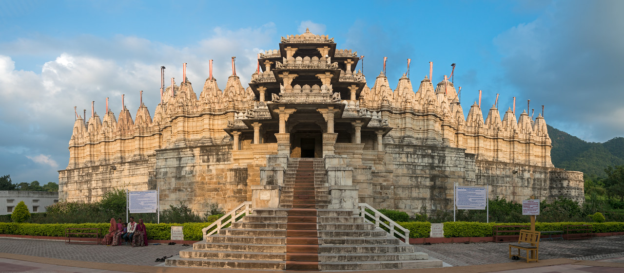 Front Entrance to Ranakpur Jain Temple<br /> Ranakpur is widely known for its marble Jain temple dedicated to Tirthankara Adinatha, and said to be the most spectacular of the Jain temples and is one among the most famous places to visit in Pali, Rajasthan. Ranakpur is a village located in a valley on the western side of the Aravalli Range. Near Sadri town in Desuri tehsil in the Pali district of Rajasthan, Western India. It is located between Jodhpur and Udaipur.<br /> <br /> Constructed between 1437 to 1458, copper-plate inscriptions at the temple record that it was inspired by a dream of a celestial vehicle, Dhanna Shah, with the patronage of Rana Kumbha, then ruler of Mewar.