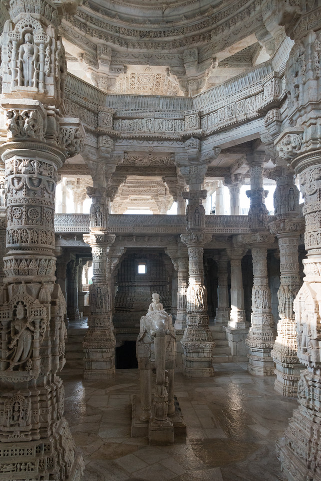Ranakpur Jain Temple located in Pali, Rajasthan is dedicated to Tirthankara Adinatha, and said to be the most spectacular of the Jain temples. Light colored marble has been used for the construction of this grand temple with its distinctive domes, shikhara, turrets and cupolas. Over 1,444 marble pillars, carved in exquisite detail, support the temple. The pillars are all differently carved and no two pillars are the same. Another unique aspect is that all the statues face one or the other statue.
