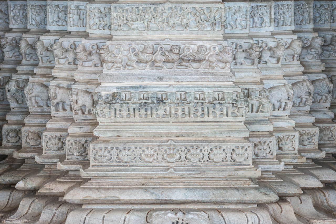 Detailed architectural marble work at the large Jain temple in Ranakpur, Rajasthan, India. Ranakpur Jain Temple is dedicated to Tirthankara Adinatha, and said to be the most spectacular of the Jain temples and is one among the most famous places to visit in Pali, Rajasthan. Constructed between 1437 to 1458, copper-plate inscriptions at the temple record that it was inspired by a dream of a celestial vehicle, Dhanna Shah, with the patronage of Rana Kumbha, then ruler of Mewar.