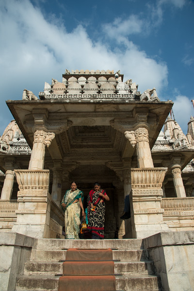 Lady pilgrims at the front entrance to Ranakpur Jain Temple. Ranakpur is widely known for its marble Jain temple dedicated to Tirthankara Adinatha, and said to be the most spectacular of the Jain temples and is one among the most famous places to visit in Pali, Rajasthan. Constructed between 1437 to 1458, copper-plate inscriptions at the temple record that it was inspired by a dream of a celestial vehicle, Dhanna Shah, with the patronage of Rana Kumbha, then ruler of Mewar.