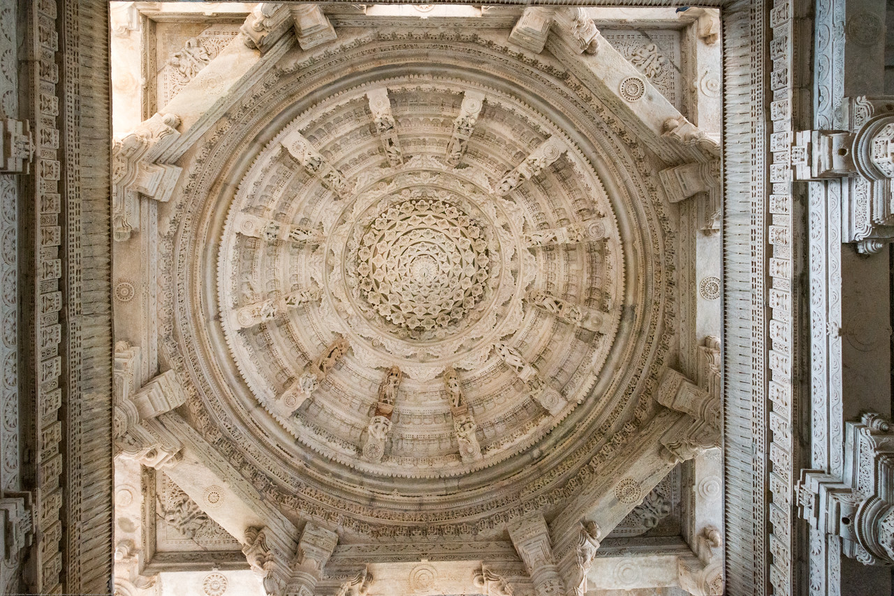 Ceiling details of the dome inside the large Jain temple in Ranakpur, Rajasthan, India. Ranakpur Jain Temple is dedicated to Tirthankara Adinatha, and said to be the most spectacular of the Jain temples and is one among the most famous places to visit in Pali, Rajasthan. Constructed between 1437 to 1458, copper-plate inscriptions at the temple record that it was inspired by a dream of a celestial vehicle, Dhanna Shah, with the patronage of Rana Kumbha, then ruler of Mewar.