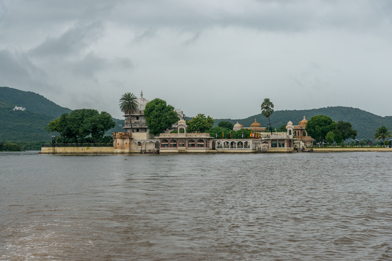 """Jagmandir (Jag Mandir) seen from a boat on Lake Pichola.<br /> <br /> Jag Mandir is a palace built on an island in the Lake Pichola. It is also called the """"Lake Garden Palace"""". The palace is located in Udaipur city in the Indian state of Rajasthan."""