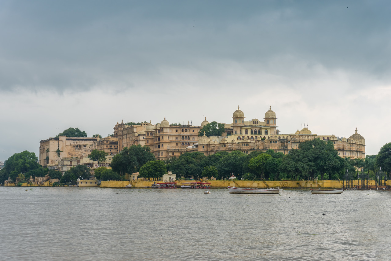City Palace, Udaipur, Rajasthan, India as seen from Lake Pichola.<br /> A palace complex situated in the city of Udaipur, Rajasthan. It was built over a period of nearly 400 years, with contributions from several rulers of the Mewar dynasty. Construction began in 1553, started by Maharana Udai Singh II of the Sisodia Rajput family as he shifted his capital from the erstwhile Chittor to the new found city of Udaipur. The palace is located on the east bank of Lake Pichola and has several palaces built within its complex.