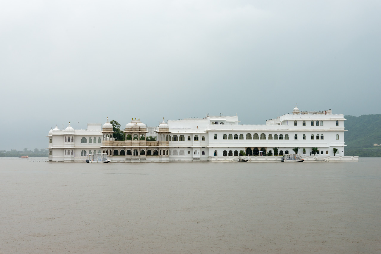 Taj Lake Palace on Lake Pichola, Udaipur, RJ, India<br /> Set in an 18th-century palace encompassing a Lake Pichola island, this luxury marble hotel, with original art, ornate details and glasswork, is a short boat ride from City Palace and was once featured in a James Bond film.