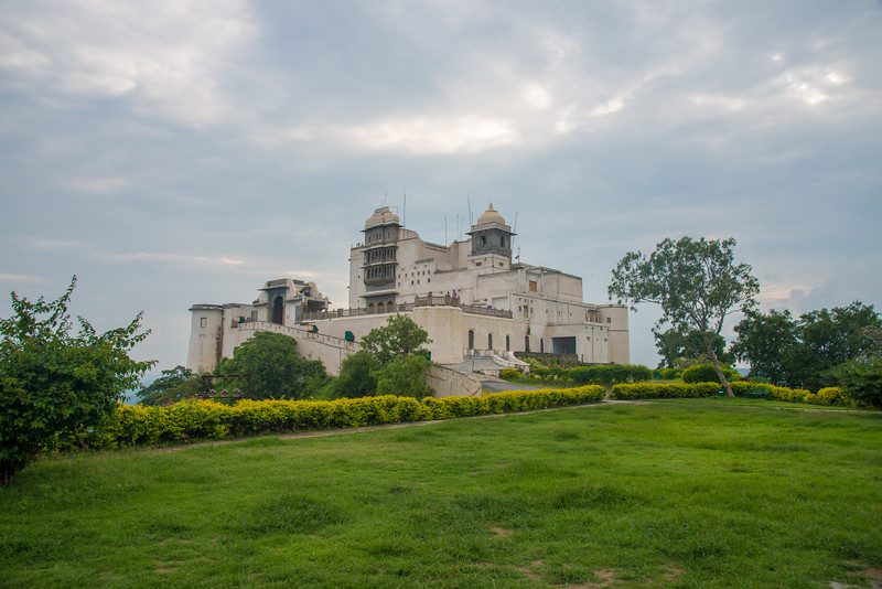 Manicured lawns and gardens at The Monsoon Palace (Sajjan Garh Palace), - a hilltop palatial residence in the city of Udaipur, Rajasthan in India, overlooking the Fateh Sagar Lake.