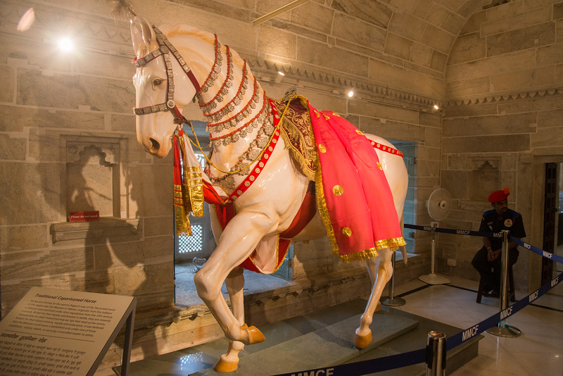 Traditional Caparisoned Horse<br /> Horses are intrisic to the warriro Rajput's way of life. The prized horse of this region was the Marwari or Malani, originally from the Jodhpur or Marwar area. It was believed that the Marwari could leave a battlefield only under one of the three conditions: victory, death or carrying a wounded master to safety.<br /> <br /> The City Palace Museum, Udaipur was set up in 1969 by Maharana Bhagwat Singh ji. Rajasthan, India.
