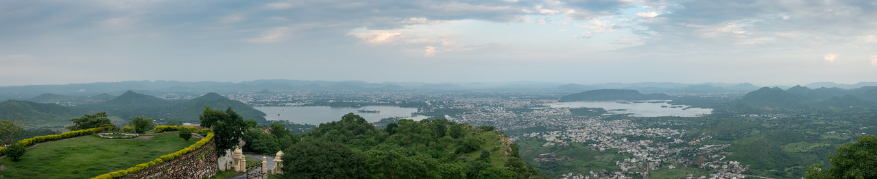 Panoramic view of Udaipur City from The Monsoon Palace, also known as the Sajjan Garh Palace - a hilltop palatial residence in the city of Udaipur, Rajasthan in India, overlooking the Fateh Sagar Lake. The palace, built with white marble, is located on Bansdara peak of the Aravalli hill range at an elevation of 944 m (3100 ft) above mean sea level, overlooking Lake Pichola from the west about 1,100 ft (340 m) below the palace. The intention of the original planner, Maharana Sajjan Singh, was to build a nine storey complex, basically as an astronomical centre and to keep track of the movement of monsoon clouds in the area surrounding the palace, and also to provide employment to people. It was also meant to serve as a resort for the royal family.