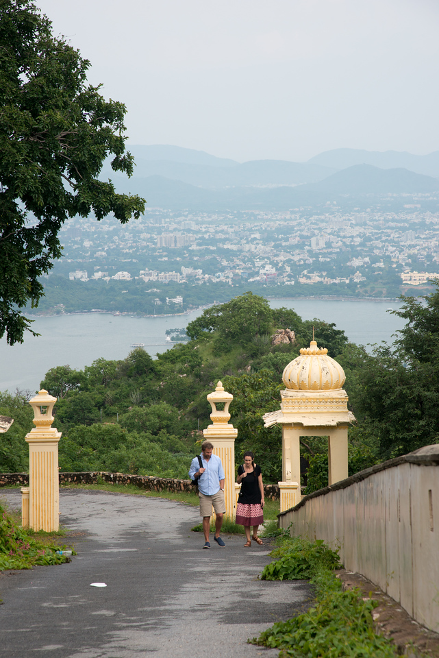 Visitors to The Monsoon Palace (Sajjan Garh Palace) - a hilltop palatial residence in the city of Udaipur, Rajasthan in India.