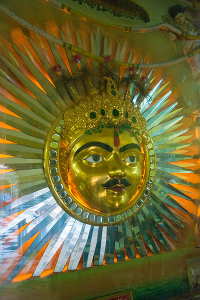 Sun-face emblems, in gleaming brass, religious insignia of the Sisodia dynasty are a recurring display at several locations in the City Palace with one being depicted on the façade of the Manak Chowk. The largest of such an emblem is also seen on the wall of the Surya Chopar, a reception centre at the lower level. Surya or Sun emblem of the Mewar dynasty. City Palace, Udaipur, Rajasthan, India.