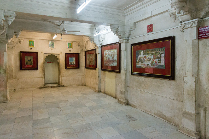 Wall paintings line the passages in City Palace, Udaipur, Rajasthan, India.
