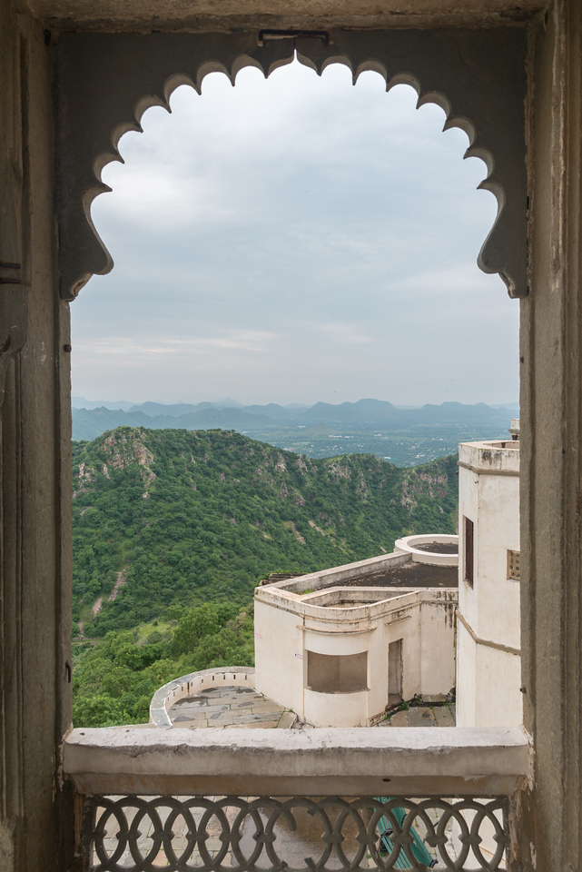 View from The Monsoon Palace (Sajjan Garh Palace)  a hilltop palatial residence in the city of Udaipur, Rajasthan in India. The palace, built with white marble, is located on Bansdara peak of the Aravalli hill range at an elevation of 944 m (3100 ft) above mean sea level, overlooking Lake Pichola from the west about 1,100 ft (340 m) below the palace. The intention of the original planner, Maharana Sajjan Singh, was to build a nine storey complex, basically as an astronomical centre and to keep track of the movement of monsoon clouds in the area surrounding the palace, and also to provide employment to people. It was also meant to serve as a resort for the royal family.