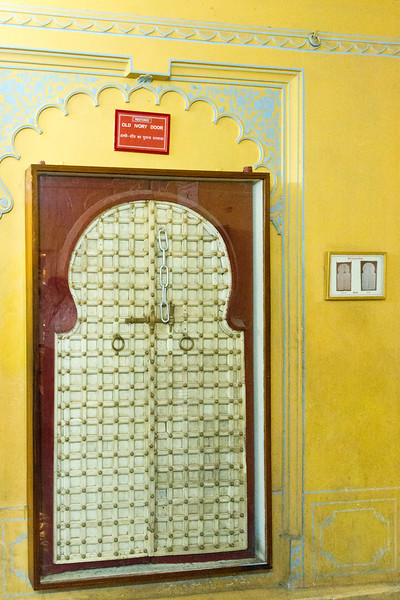 Old ivory door which has been restored inside City Palace, Udaipur, Rajasthan, India.