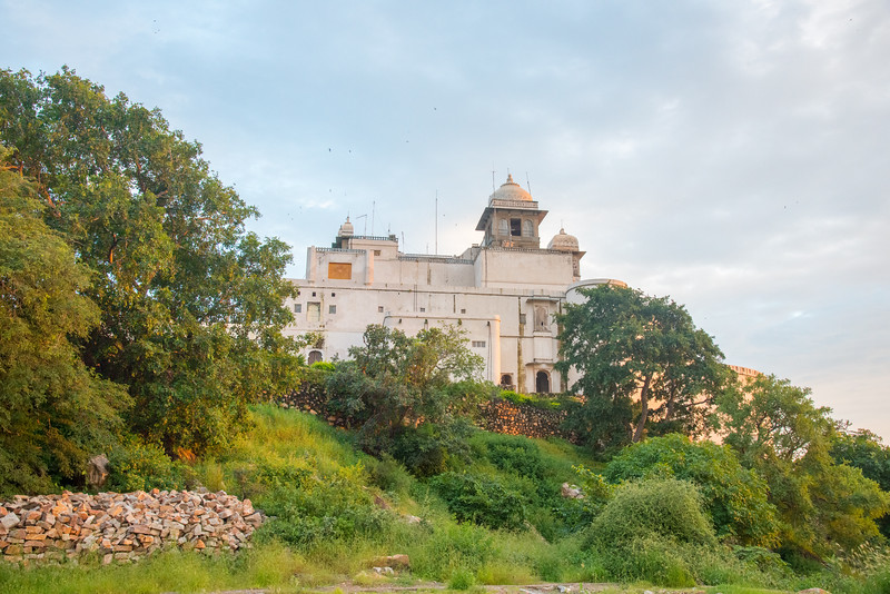 Late evening view of the Monsoon Palace, also known as the Sajjan Garh Palace. A hilltop palatial residence in the city of Udaipur, Rajasthan in India, overlooking the Fateh Sagar Lake. The palace, built with white marble, is located on Bansdara peak of the Aravalli hill range at an elevation of 944 m (3100 ft) above mean sea level, overlooking Lake Pichola from the west about 1,100 ft (340 m) below the palace. The intention of the original planner, Maharana Sajjan Singh, was to build a nine storey complex, basically as an astronomical centre and to keep track of the movement of monsoon clouds in the area surrounding the palace, and also to provide employment to people. It was also meant to serve as a resort for the royal family.