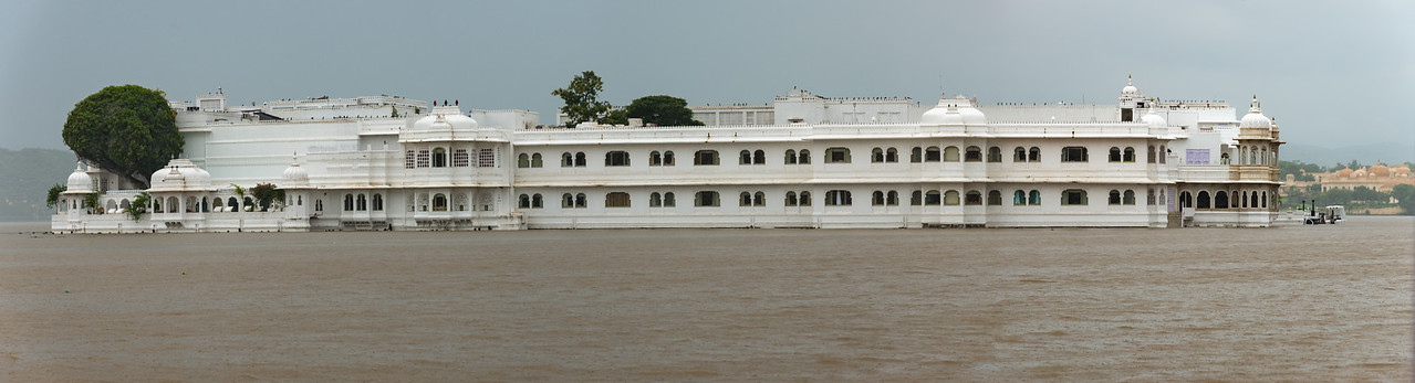 Panoramic view of Taj Lake Palace on Lake Pichola, Udaipur, RJ, India<br /> Set in an 18th-century palace encompassing a Lake Pichola island, this luxury marble hotel, with original art, ornate details and glasswork, is a short boat ride from City Palace and was once featured in a James Bond film.