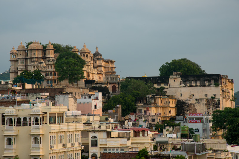 Elevated view in evening light of City Palace, Udaipur, Rajasthan, India.