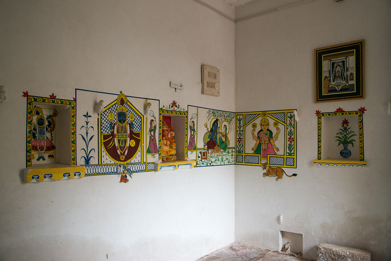 Paintings of various Hindu Gods on the walls of City Palace, Udaipur, Rajasthan, India.